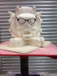 Start carving the face and mark up for the feet