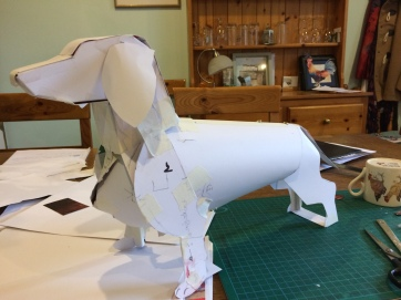 The first maquette is made and I am now happy with the look and the mechanics of the adjustments. The back legs can pull for longer dogs and the chest can expand for larger chested ones. The legs and head are really only there for aesthetic reasons.