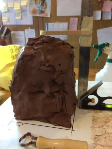 First I measured approximately a 50% size block of clay. I wanted to make the largest piece I could so decided to work the piece on the diagonal.