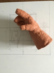 Maquette for the glove. This is sculpted from Plasticine at 50% scale.