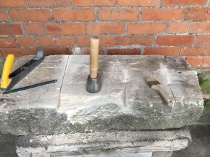 This shows the original stone which came from the commissioners house during a renovation.