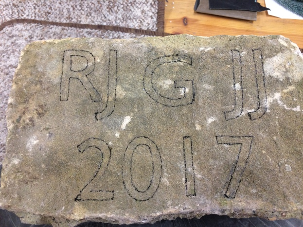 Family initials drawn out on the stone I was given.