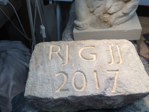 Carved out the initials without cleaning the stone.